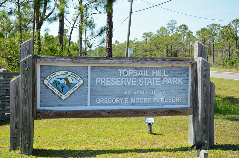 "We read that the Topsail Hill Preserve State Park has over 3 miles of beautiful sandy beaches with 25-foot tall sand dunes, RV camping facilities and furnished bungalows. But I wouldn't know because the day we arrived the Ranger said ""this here park is for campers only and if you're not camping you can't go in"".  So all I got is a picture of is their tram!"