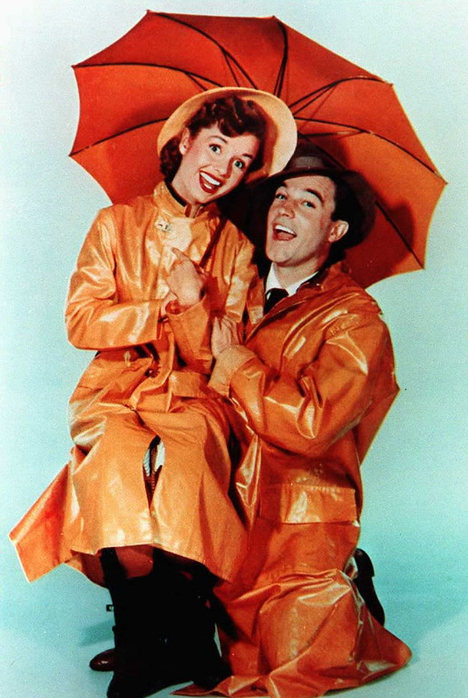 ". This undated file photo shows US actor Gene Kelly with actress Debbie Reynolds from the movie ""Singin\' in the Rain.\""  Reynolds, star of the 1952 classic \""Singin\' in the Rain\"" died Wednesday, Dec. 28, 2016, according to her son Todd Fisher. She was 84. (FILE/AFP/Getty Images)"