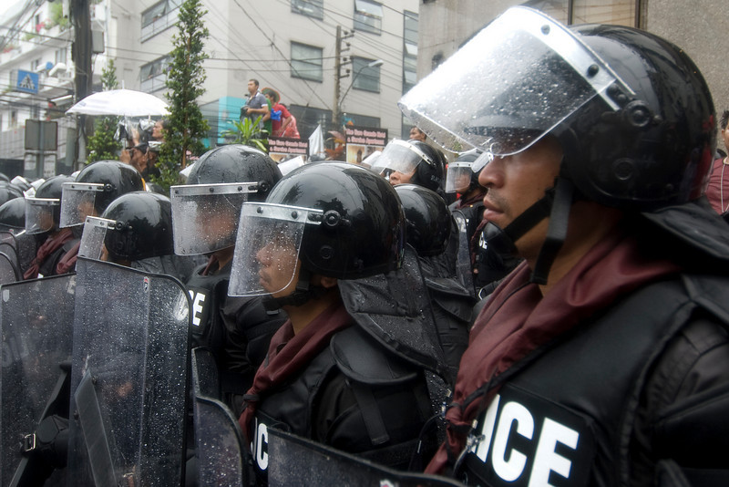 Riot police wet from rain during Red Shirt Protest