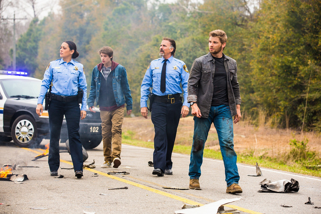 . Pilot - Deputy Linda (Natalie Martinez, left), Joe (Colin Ford), Sheriff Perkins (Jeff Fahey) and  Dale \'Barbie\' Barbara (Mike Vogel Pictured L-R) and the residents of Chester\'s Mill find themselves suddenly and inexplicably sealed off from the rest of the world by a massive transparent dome, on UNDER THE DOME premiering Monday, June 24 (10:00-11:00 PM, ET/PT) on the CBS Television Network.   UNDER THE DOME is based on Stephen King\'s bestselling novel.  Photo: Michael Tackett/©2013 CBS Broadcasting Inc. All Rights Reserved.