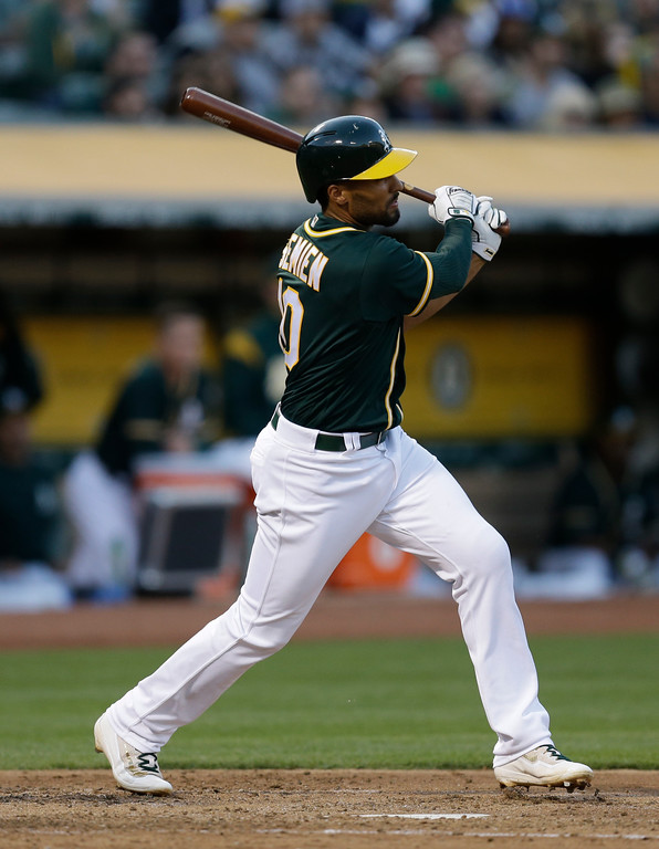 . Oakland Athletics\' Marcus Semien watches his RBI sacrifice fly off Cleveland Indians\' Carlos Carrasco during the third inning of a baseball game Friday, July 14, 2017, in Oakland, Calif. (AP Photo/Ben Margot)