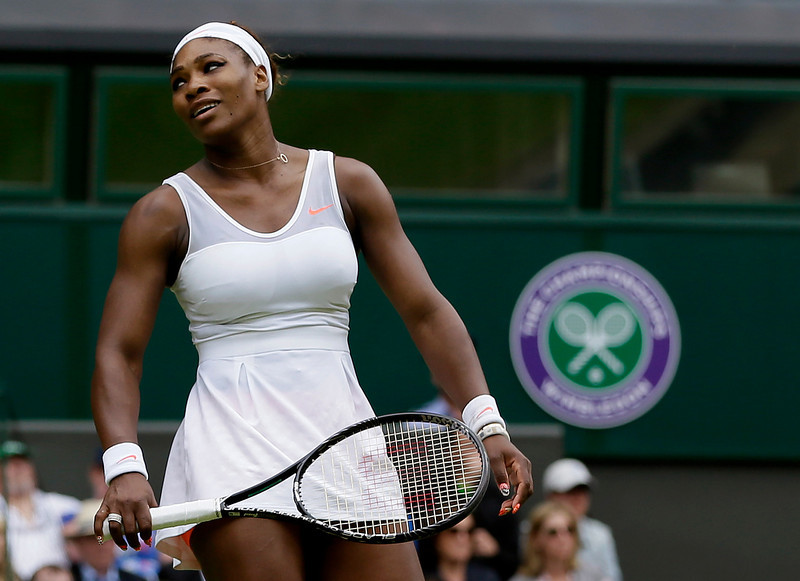 . Serena Williams of the United States reacts during her match against Sabine Lisicki of Germany in a Women\'s singles at the All England Lawn Tennis Championships in Wimbledon, London, Monday, July 1, 2013. (AP Photo/Alastair Grant)