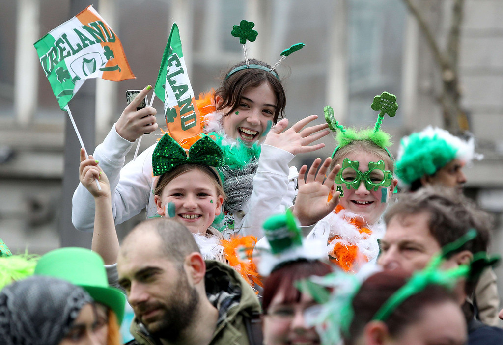 . Spectators waving the Irish flag attend St Patrick\'s Day parade in Dublin on March 17, 2014. More than 100 parades are being held across Ireland to mark St Patrick\'s Day, the feast day of the patron saint of Ireland, with up to 650,000 spectators expected to attend the parade in Dublin. AFP PHOTO/ PETER MUHLY/AFP/Getty Images