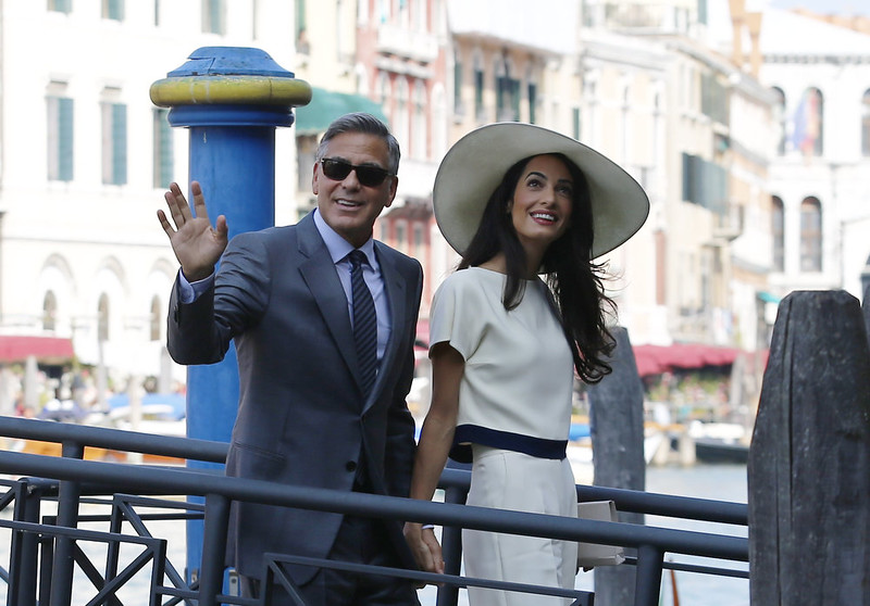 . US actor George Clooney and British lawyer Amal Alamuddin arrive on September 29, 2014 at the palazzo Ca Farsetti in Venice, for a civil ceremony to officialise their wedding. PIERRE TEYSSOT/AFP/Getty Images