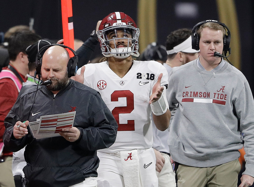 . Alabama quarterback Jalen Hurts watches from the sidelines during the second half of the NCAA college football playoff championship game against Georgia, Monday, Jan. 8, 2018, in Atlanta. (AP Photo/David J. Phillip)