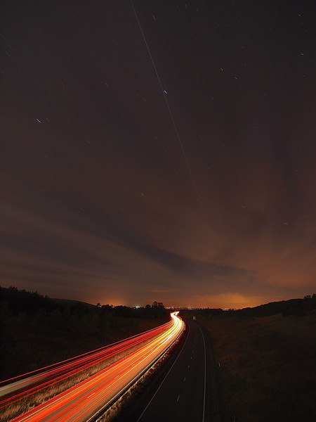 17 Oct 2013. iss flyby 2009hrs. E5 F4 15s ISO 250 7mm. I shot this same composition with the OMD EM-5 (see pic before). Car tails with iss over A14 East Midlands.