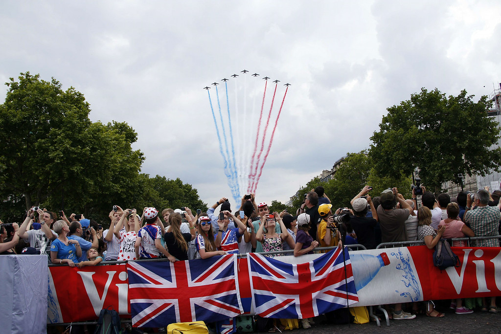 ". France\'s acrobatic patrol ""Patrouille de France\"" flies over the Champs Elysees avenue during the 137.5 km twenty-first and last stage of the 101st edition of the Tour de France cycling race on July 27, 2014 between Evry and Paris.   KENZO TRIBOUILLARD/AFP/Getty Images"