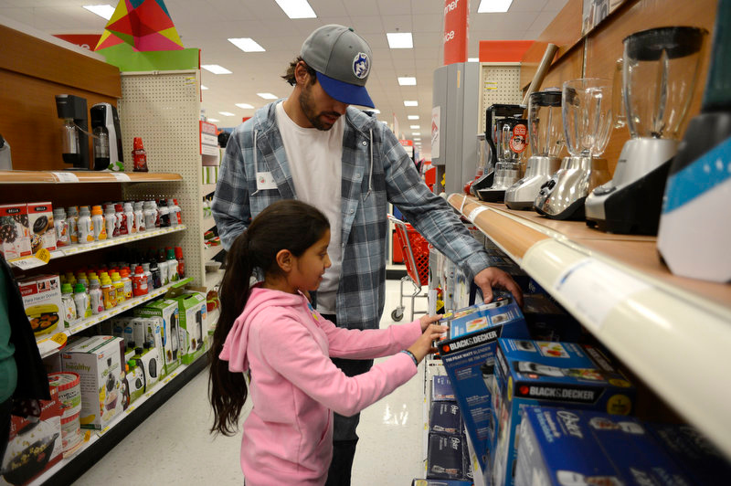 . Broncos wide receiver Eric Decker helps out Ashley pick out a blender during her shopping spree at Target. Eric Decker and Demaryius Thomas along with other teammates reached out to help children in their community by hosting a holiday shopping trip at Super Target Tuesday, December 11, 2012 in Lone Tree. 25 children, ranging in age from 8 to 14, are being rewarded for their outstanding participation in their after-school program with a trip to buy holiday presents. John Leyba, The Denver Post