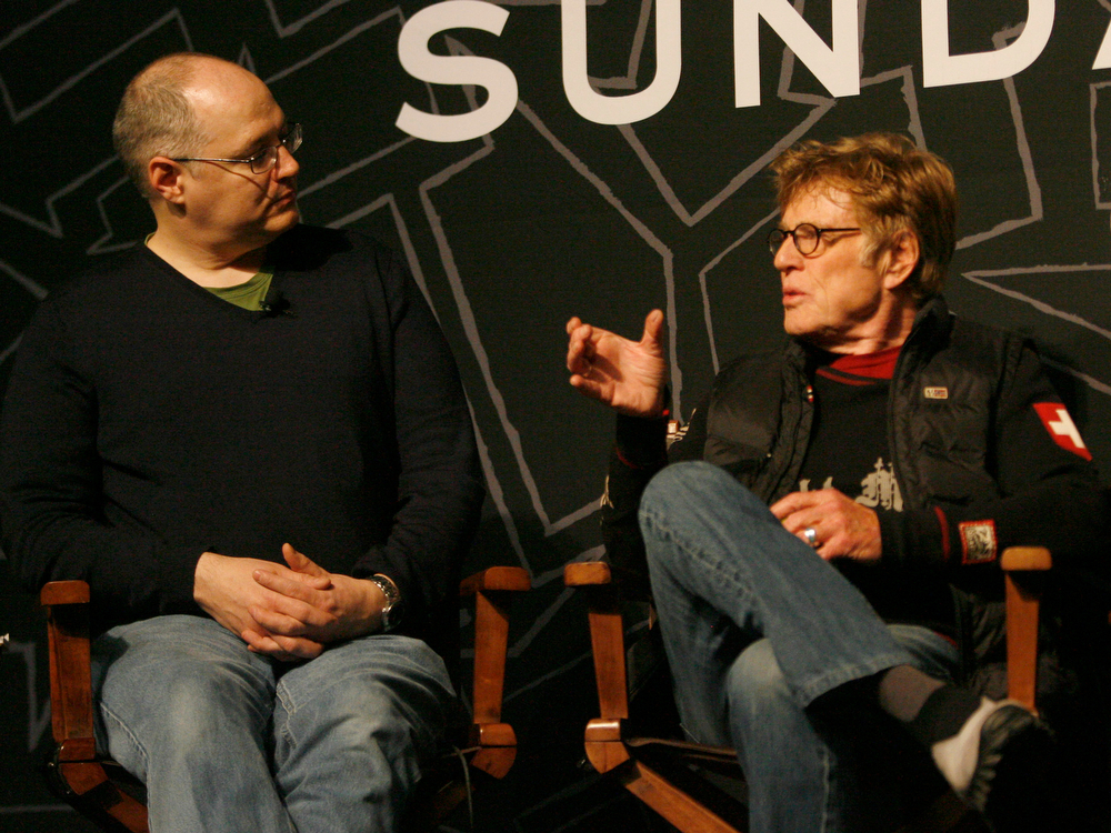 Description of . Salt Lake Tribune film critic, Sean Means (left) listens as Robert Redford talks about this years Sundance Film Festival at the opening press conference of the Sundance Film Festival at the Egyptian theater in Park City,  Thursday, January 17, 2013. Rick Egan  | The Salt Lake Tribune