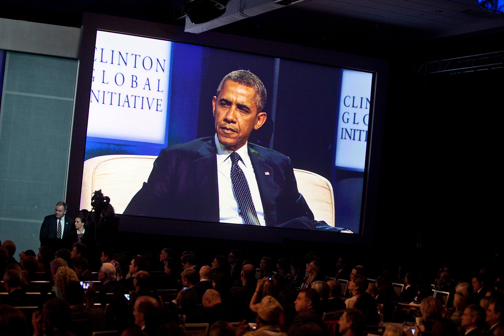 . NEW YORK - SEPTEMBER 24: U.S. President Barack Obama appears on a large screen during the annual Clinton Global Initiative (CGI) meeting on September 24, 2013 in New York City. Timed to coincide with the United Nations General Assembly, CGI brings together heads of state, CEOs, philanthropists and others to help find solutions to the world\'s major problems.  (Photo by Ramin Talaie/Getty Images)