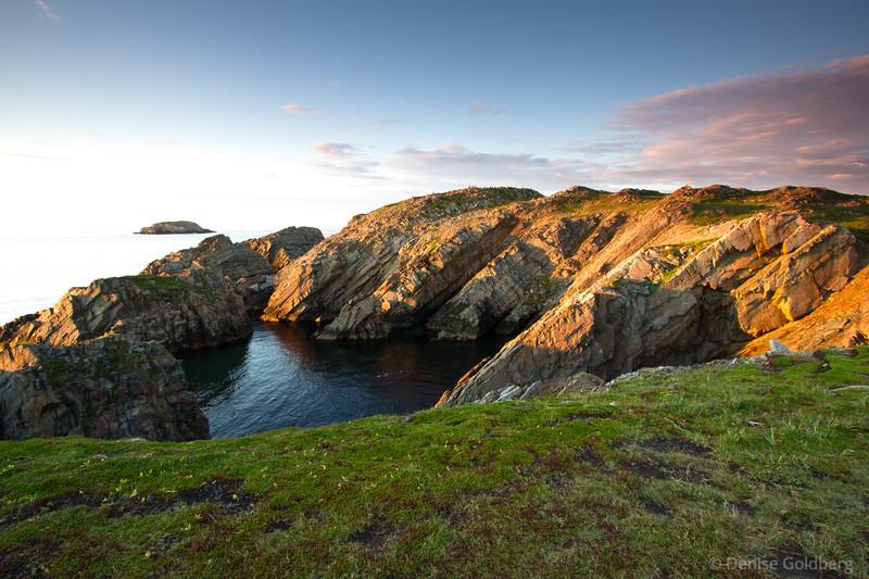 Late day light paints rock formations along the coast, Bonavista, Newfoundland