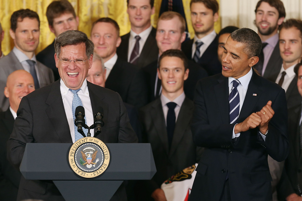. Chicago Blackhawks principal owner Rocky Wirtz laughs as U.S. President Barack Obama pretends to swing a hockey stick during a celebration of 2013 National Hockey League champions in the East Room of the White House November 4, 2013 in Washington, DC.  (Photo by Chip Somodevilla/Getty Images)