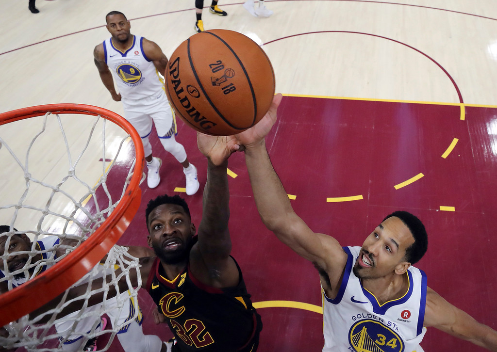 . Golden State Warriors\' Shaun Livingston (34) and Cleveland Cavaliers\' Jeff Green vie for a rebound during the first half of Game 4 of basketball\'s NBA Finals, Friday, June 8, 2018, in Cleveland. (Kyle Terada/Pool Photo via AP)