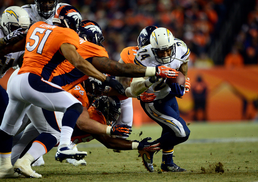 . DENVER, CO - DECEMBER 12: San Diego Chargers running back Ryan Mathews (24) gains a first down in the first half.  The Denver Broncos vs. the San Diego Chargers at Sports Authority Field at Mile High in Denver on December 12, 2013. (Photo by AAron Ontiveroz/The Denver Post)