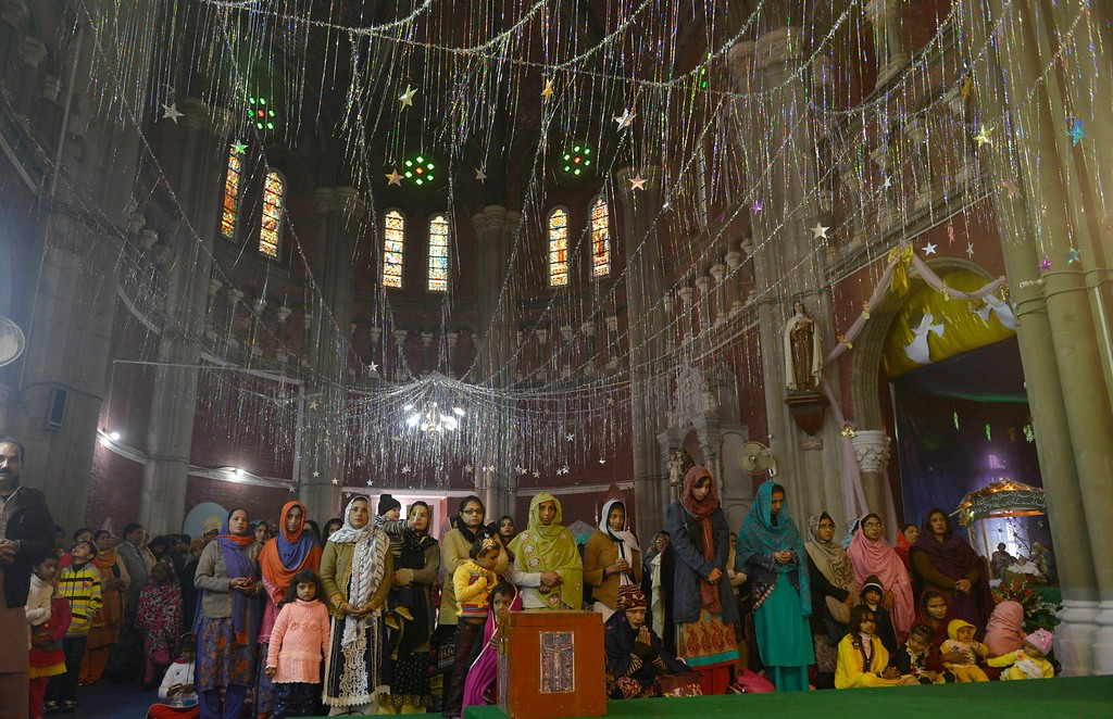 . Pakistani minority Christians attend a Christmas mass at a Cathedral Church in Lahore on December 25, 2014. Christians around the world are celebrating Christmas Day, a holiday commemorating the birth of Jesus Christ. Arif Ali/AFP/Getty Images
