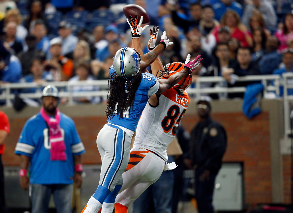 . Cincinnati Bengals tight end Tyler Eifert (85) catches a 32-yard touchdown reception as Detroit Lions cornerback Rashean Mathis (31) defends in the third quarter of an NFL football game on Sunday, Oct. 20, 2013, in Detroit. (AP Photo/Rick Osentoski)