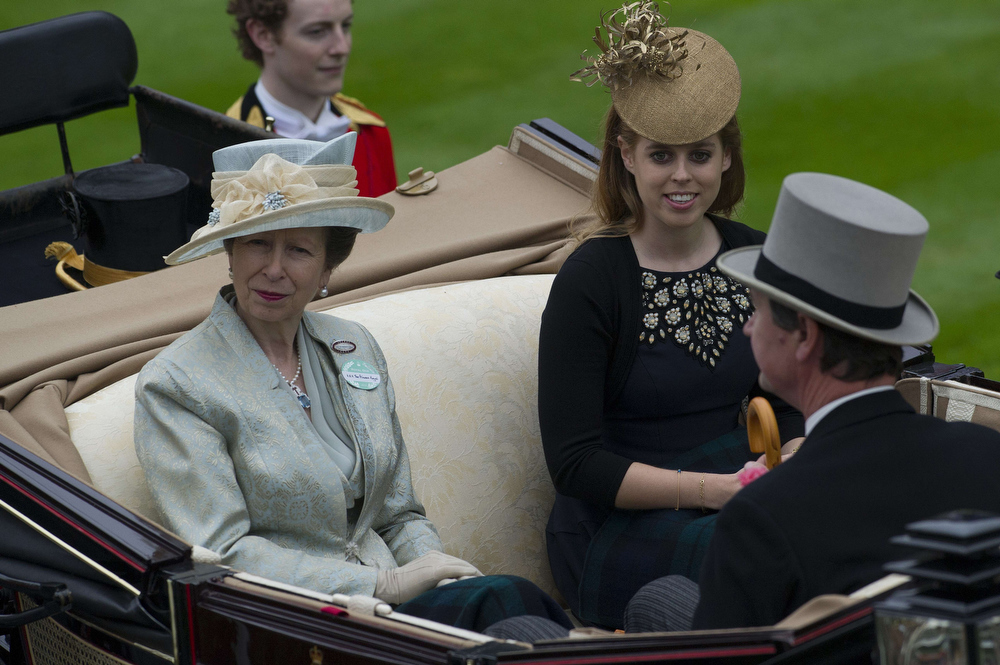 . Britain\'s Princess Anne (L) and Princess Beatrice arrive on the third day of Royal Ascot, in Berkshire, west of London, on June 20, 2013. The five-day meeting is one of the highlights of the horse racing calendar. Horse racing has been held at the famous Berkshire course since 1711 and tradition is a hallmark of the meeting. Top hats and tails remain compulsory in parts of the course while a daily procession of horse-drawn carriages brings the Queen to the course.   CARL COURT/AFP/Getty Images