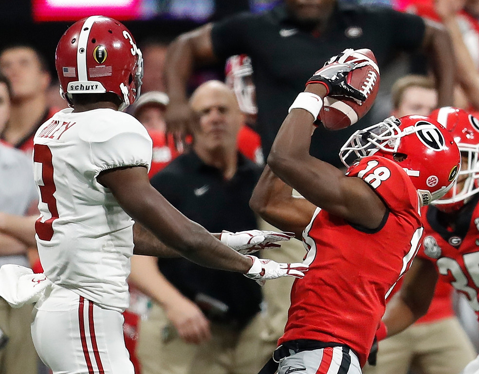 . Georgia defensive back Deandre Baker intercepts a pass in front of Alabama\'s Calvin Ridley (3) during the second half of the NCAA college football playoff championship game Monday, Jan. 8, 2018, in Atlanta. (AP Photo/David Goldman)