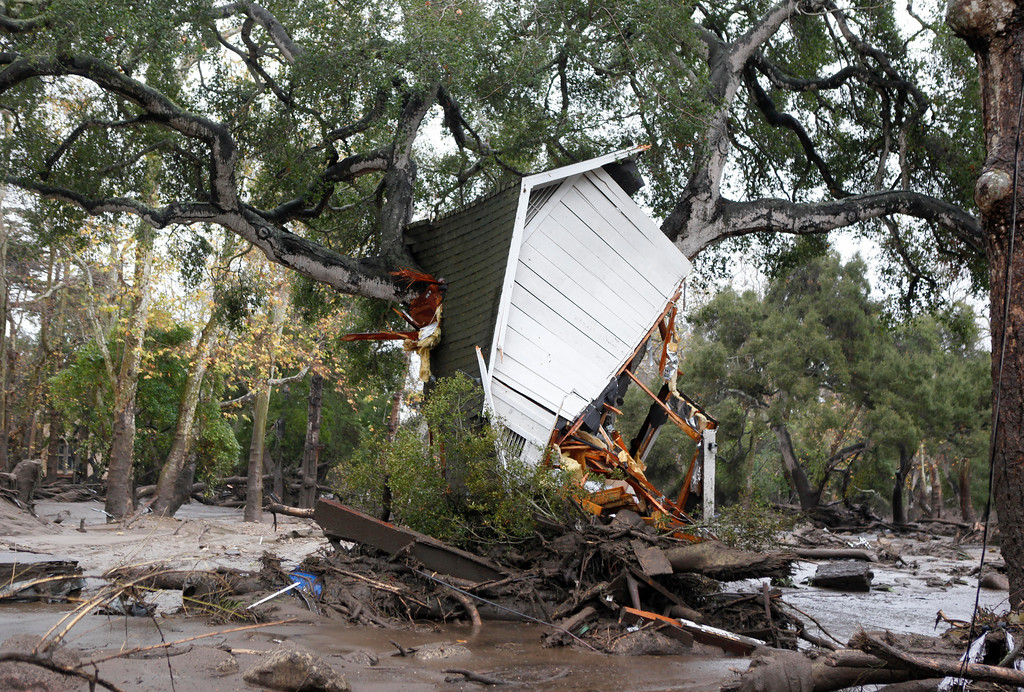 . A structure is smashed against a tree along Hot Springs Road in Montecito, Calif. after getting hit by a flash flood and debris flow on Tuesday, Jan. 9, 2018. Several homes were swept away before dawn Tuesday when mud and debris roared into neighborhoods in Montecito from hillsides stripped of vegetation during a recent wildfire. (Daniel Dreifuss)