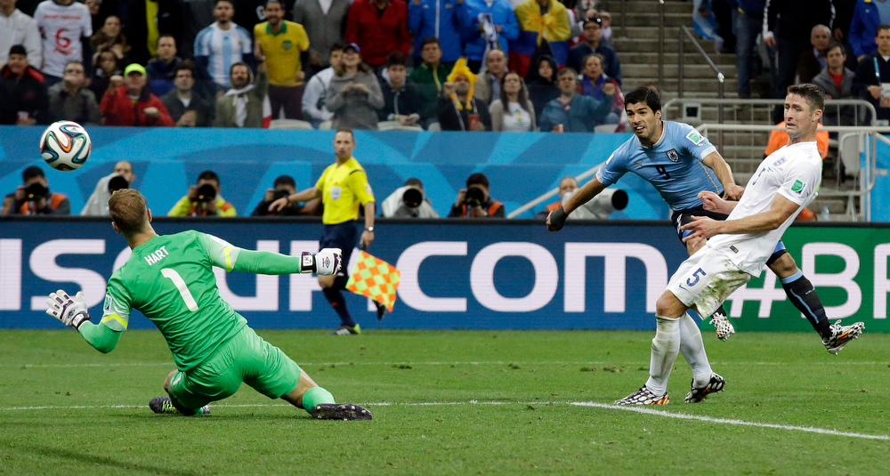 . Uruguay\'s Luis Suarez scores his side\'s second goal during the group D World Cup soccer match between Uruguay and England at the Itaquerao Stadium in Sao Paulo, Brazil, Thursday, June 19, 2014.  (AP Photo/Matt Dunham)