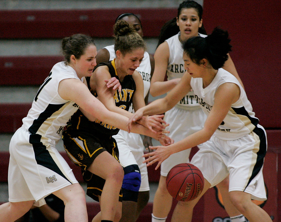 . St. Francis\' Lauren Johnson is mobbed by Mitty players in the first quarter during the CCS Open Division girls basketball finals at Santa Clara University in Santa Clara, Calif. on Saturday, March 2, 2013. The Archbishop Mitty Monarchs played the Saint Francis Lancers. (Jim Gensheimer/Staff)