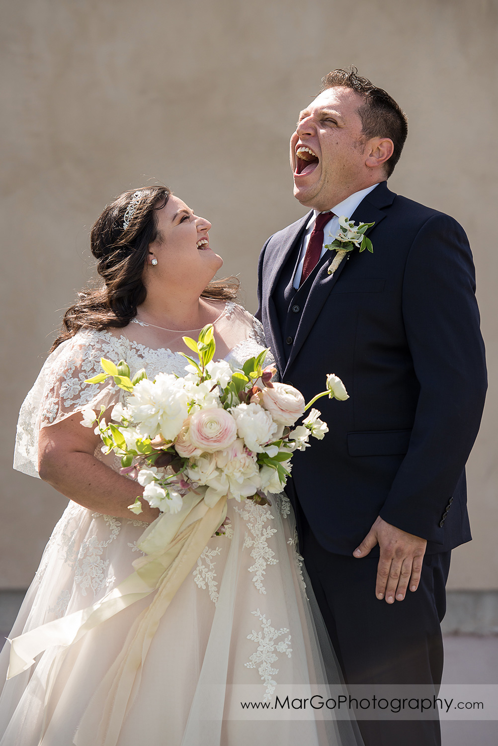 portrait of laughing bride and groom at Livermore Garre Vineyard and Winery