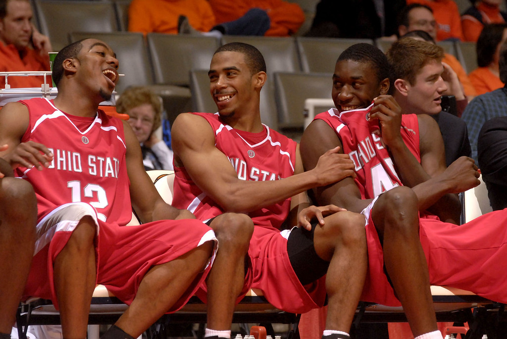 . Ohio State\'s. from left,  Ron Lewis (12), Mike Conley Jr. (1) and Othello Hunter (45) laugh it up on the bench as the final minute of the game ticks off in the second half of the NCAA basketball game against the University of Illinois at Assembly Hall  in Champaign, Ill., Saturday  afternoon,  Jan. 6, 2007. (AP Photo/Robert K. O\'Daniell)
