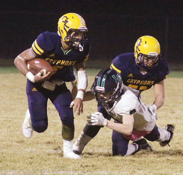 Greater Lowell Tech vs Lowell Catholic football.  Greater Lowell's Benji Hach (5) and Monetry Vilavong (53), and Lowell Catholic's Aidan Maston (9). (SUN/Julia Malakie)