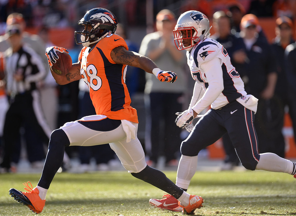 . Denver Broncos wide receiver Demaryius Thomas (88) tries to break away from the defenders in the second quarter. The Denver Broncos take on the New England Patriots in the AFC Championship game at Sports Authority Field at Mile High in Denver on January 19, 2014. (Photo by Hyoung Chang/The Denver Post)