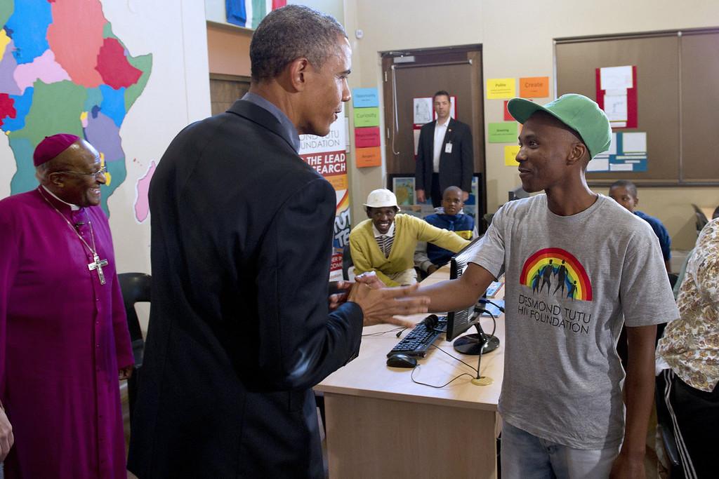 . US President Barack Obama tours a classroom alongside Nobel peace laureate Archbishop Desmond Tutu (L) at the Desmond Tutu HIV Foundation Youth Centre in Cape Town, South Africa, on June 30, 2013.  SAUL LOEB/AFP/Getty Images