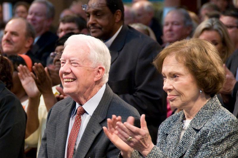 Former President Jimmy Carter and Rosalynn enjoying the program. sh