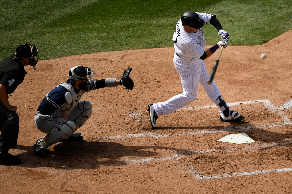 . Denver, CO - ARRIL 08: Trevor Story (27) of the Colorado Rockies batting in the second inning to drive in the first run during their home opener against the San Diego Padres at Coors Field. April 08, 2016 in Denver, CO. (Photo By Joe Amon/The Denver Post)