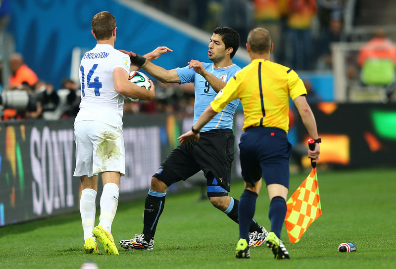 . Jordan Henderson of England and Luis Suarez of Uruguay clash during the 2014 FIFA World Cup Brazil Group D match between Uruguay and England at Arena de Sao Paulo on June 19, 2014 in Sao Paulo, Brazil.  (Photo by Jamie Squire/Getty Images)
