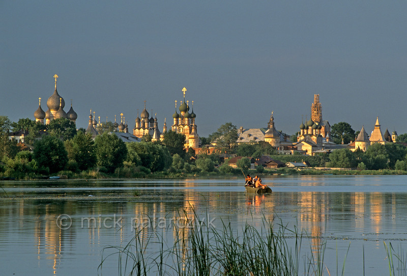 [RUSSIA.GOLDENRING 26.129] 'Fishing near the kremlin.'  Boys fishing on Lake Nero have a superb view of the many domes in the kremlin of Rostov-Veliky. Photo Mick Palarczyk.