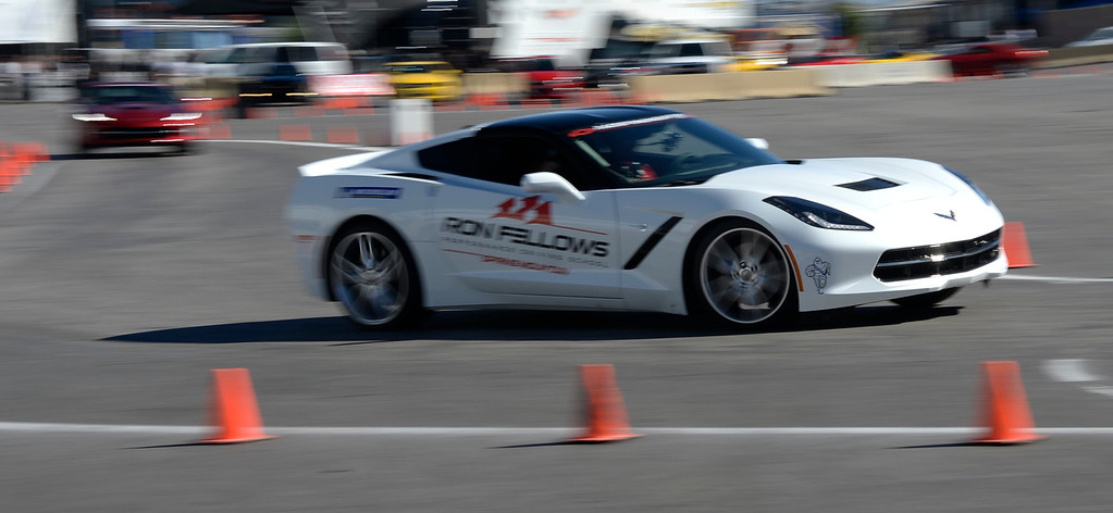 . Nov 6,2013 Las Vegas NV. USA. SEMA show goers get to take a rind in the now Chevy Corvette,  during the second day of the 2013 SEMA auto show. Photo by Gene Blevins/LA Daily News