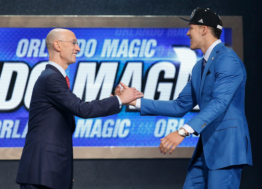 . Arizona forward Aaron Gordon is greeted by NBA Commissioner Adam Silver after being selected fourth overall by the Orlando Magic during the 2014 NBA draft, Thursday, June 26, 2014, in New York. (AP Photo/Kathy Willens)