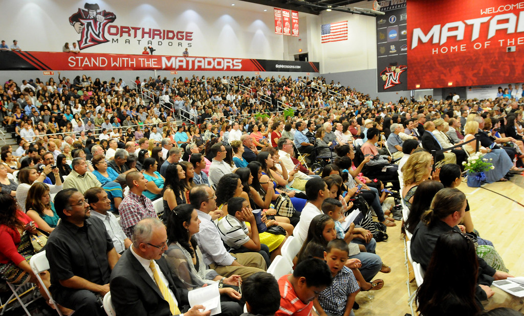 . Friends and family members during the Northridge Academy High School graduation ceremony on Thursday, June 5, 2014. (Photo by Dean Musgrove/Los Angeles Daily News)