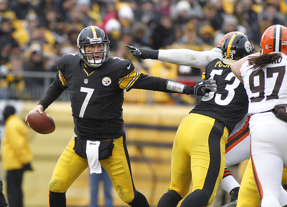 . Ben Roethlisberger #7 of the Pittsburgh Steelers is pushed out of the pocket against the Cleveland Browns during the game on December 30, 2012 at Heinz Field in Pittsburgh, Pennsylvania.  The Steelers defeated the Browns 24-10.  (Photo by Justin K. Aller/Getty Images)