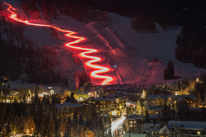 A long exposure shows the annual Torchlight Ceremony in full swing on Wednesday night in Vail. Shortly after the steady sea of red light poured into Golden Peak, fireworks ignited the sky.