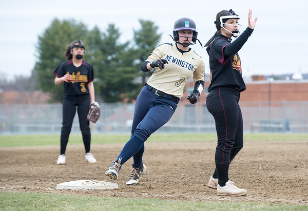 04/11/19 Wesley Bunnell | Staff New Britain softball defeated Newington on the road 4-1 on Thursday afternoon. Amanda Jacobs (5) signals no throw as Newington runner Madelyn Ellis runs into third.