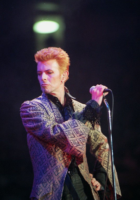 . FILE - In this Jan. 9, 1997, file photo, David Bowie performs during a concert celebrating his 50th birthday, at Madison Square Garden in New York. Bowie, the innovative and iconic singer whose illustrious career lasted five decades, died Monday, Jan. 11, 2016, after battling cancer for 18 months. He was 69. (AP Photo/Ron Frehm, File)