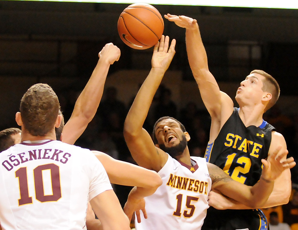 . Minnesota forward Maurice Walker, center, gets his shot blocked by South Dakota State guard Brayden Carlson, right, and forward Cody Larson, left, in the second half. (Pioneer Press: John Autey)