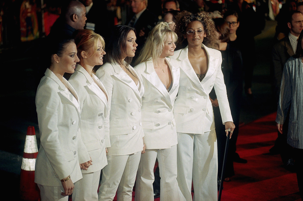 . British music sensation The Spice Girls pose for photos upon arriving at the world premiere of their new film, ?spice World,? Thursday, Jan. 22, 1998 outside the Mann?s Chinese Theatre in the Hollywood section of Los Angeles. From left are Melanie Chisholm (Sporty Spice), Geri Halliwell (Ginger Spice), Victoria Adams (Posh Spice), Emma Bunton (Baby Spice) and Melanie Brown (Scary Spice). (AP Photo/Chris Pizzello)