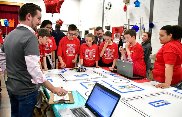 4/18/2019 Mike Orazzi | Staff Tony D'Amato while judging the Bristol Middle School Robotics Challenge Thursday.