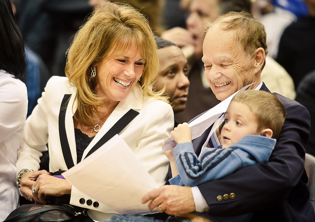 . Timberwolves owner Glen Taylor, right, and his wife Becky Mulvihill spend time with family near the team\'s bench. (Pioneer Press: Ben Garvin)
