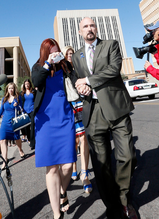 . Tanisha Sorenson, sister of murder victim Travis Alexander, cries as she leaves the court house with family and friends, Thursday, March 5, 2015, in Phoenix. A judge declared a mistrial Thursday in the Jodi Arias sentencing retrial after a jury deadlocked on whether the convicted murderer should be executed or sent to prison for life for the 2008 killing of Travis Alexander.(AP Photo/Matt York)