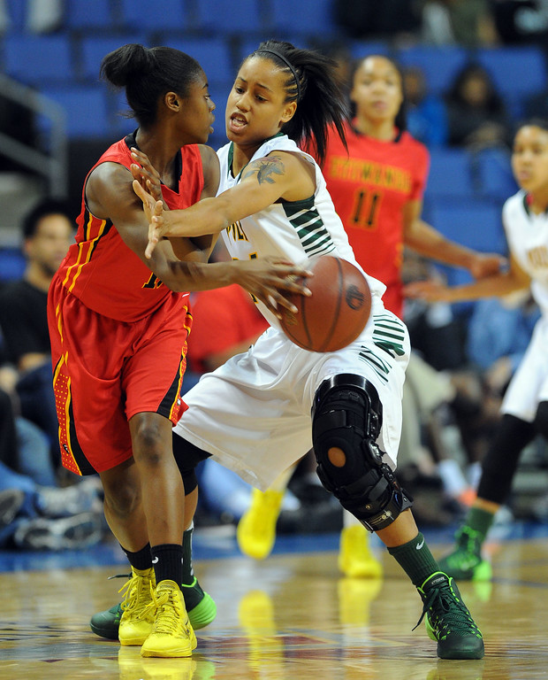 . Etiwanda\'s Kyla Martin passes around Poly defender Emoni Jackson at Citizens Business Bank Arena in Ontario, CA on Saturday, March 22, 2014. Long Beach Poly vs Etiwanda in the CIF girls open division regional final. 1st half, Photo by Scott Varley, Daily Breeze)