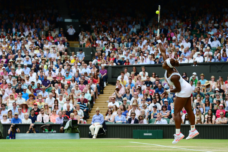. Serena Williams of United States of America serves during her Ladies\' Singles fourth round match against Sabine Lisicki of Germany on day seven of the Wimbledon Lawn Tennis Championships at the All England Lawn Tennis and Croquet Club on July 1, 2013 in London, England.  (Photo by Mike Hewitt/Getty Images)