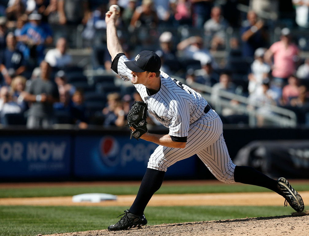 . New York Yankees relief pitcher David Robertson delivers in the ninth inning of the Yankees 1-0 shutout of the Detroit Tigers in a baseball game at Yankee Stadium in New York, Thursday, Aug. 7, 2014.  (AP Photo/Kathy Willens)