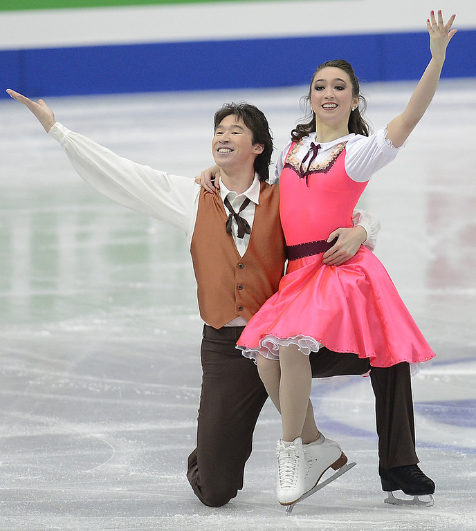 . Cathy Reed and Chris Reed of Japan skate in the Ice Dance Short Dance during day one of the ISU Four Continents Figure Skating Championships at Osaka Municipal Central Gymnasium on February 8, 2013 in Osaka, Japan.  (Photo by Atsushi Tomura/Getty Images)